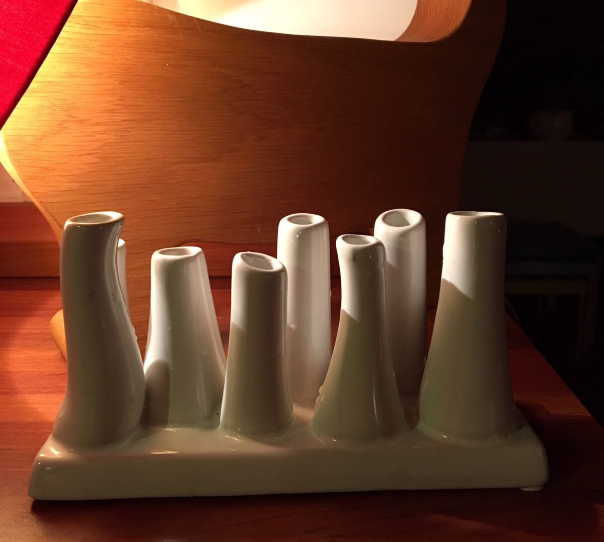 funky white vase with small white asymmetrical towers